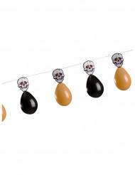Guirlande med kranier samt orange og sorte balloner