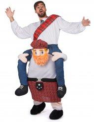 Kostume mand på ryggen af en skotte
