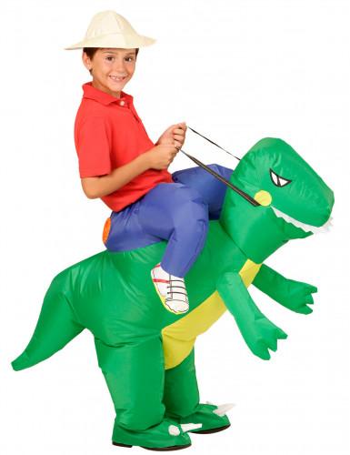 Kostume udforsker på ryggen af dinosaur til børn